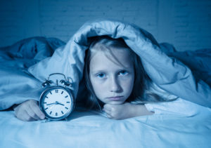 Young girl with sleep apnea in Topeka